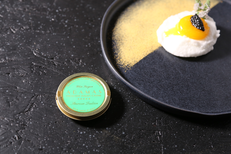 Fresh egg yolk marinated and Green Adamas