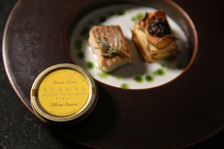 Slice of black cod marinated and Yellow Adamas
